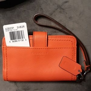 NWT Coach Legacy bright coral Leather Phone Wrstlt